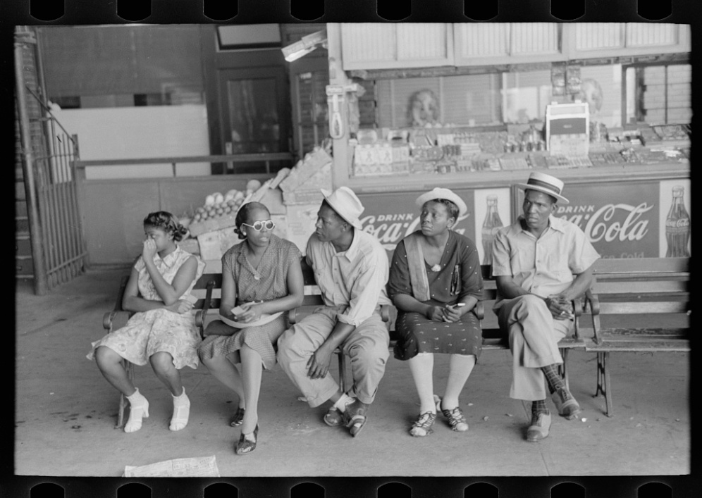 Russell Lee, photographer. Negroes waiting at streetcar terminal for cars, Oklahoma City, Oklahoma. Oklahoma Oklahoma City, 1939. July. Photograph. Retrieved from the Library of Congress, https://www.loc.gov/item/fsa1997026810/PP/. (Accessed November 01, 2017.)