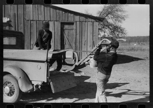Lee, Russell, photographer. [Untitled photo, possibly related to: Son of Pomp Hall, Negro tenant farmer, carrying can full of mash to hogpen, Creek County, Oklahoma. See general caption, number 23]. Creek County Oklahoma, 1940. [Feb] Photograph. Retrieved from the Library of Congress, https://www.loc.gov/item/fsa1998000248/PP/. (Accessed November 03, 2017.)