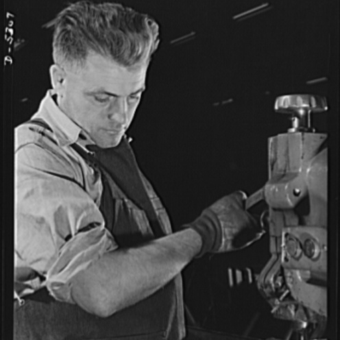 United States Office Of War Information, Bransby, David, photographer. Production. Aircraft. A precision machinist in the machine shop of a large Western aircraft factory. Since variation from perfection may mean a jammed gun, a faulty landing-gear or a stalled engine, men like this are now at an all time premium. Burbank California Los Angeles County United States, 1942. June. Photograph. Retrieved from the Library of Congress, https://lccn.loc.gov/2017692987. (Accessed November 02, 2017.)