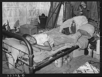 Russell Lee, photographer. Negro agricultural day laborer taking a nap in his home. Muskogee, Oklahoma. Muskogee County. Muskogee Muskogee County Oklahoma, 1939. June. Photograph. Retrieved from the Library of Congress, https://www.loc.gov/item/fsa2000014628/PP/. (Accessed October 30, 2017.)