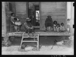 Russell Lee, photographer. Negro tenant farmer and his family on front porch of their home in Wagoner County, Oklahoma. Oklahoma Wagoner County, 1939. June. Photograph. Retrieved from the Library of Congress, https://www.loc.gov/item/fsa2000014847/PP/. (Accessed October 30, 2017.)