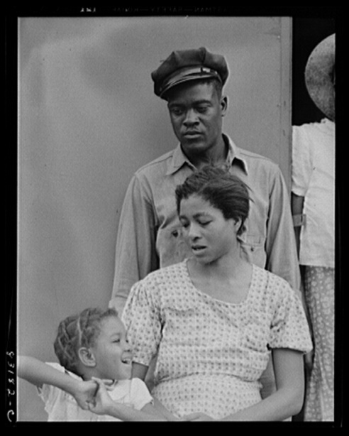 John Collier, Jr., photographer. Bridgeton, New Jersey. FSA Farm Security Administration agricultural workers' camp. Councilman and family. Bridgeton Cumberland County New Jersey, 1942. June. Photograph. Retrieved from the Library of Congress, https://www.loc.gov/item/fsa2000054218/PP/. (Accessed November 02, 2017.)