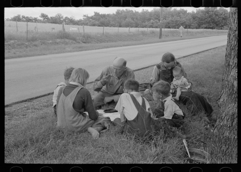 Russell Lee, photographer. White migrant family eating lunch of blackberry pie on the highway east of Fort Gibson, Oklahoma. Fort Gibson Muskogee County Oklahoma, 1939. June. Photograph. Retrieved from the Library of Congress, https://www.loc.gov/item/fsa1997026487/PP/. (Accessed November 02, 2017.)