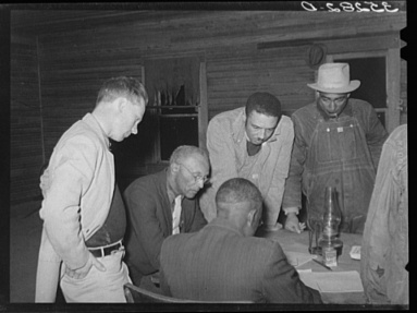 Russell Lee, photographer. Officials of agricultural workers union at Tabor, Oklahoma. Creek County Oklahoma Tabor, 1940. Feb. Photograph. Retrieved from the Library of Congress, https://www.loc.gov/item/fsa2000016546/PP/. (Accessed November 02, 2017.)